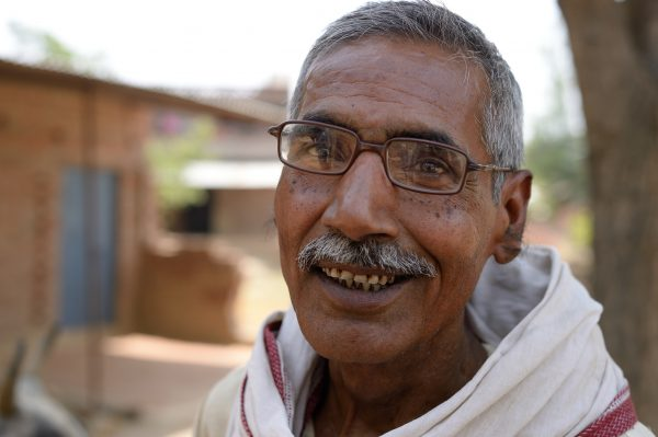 Man in South Asia smiling for our photographer.