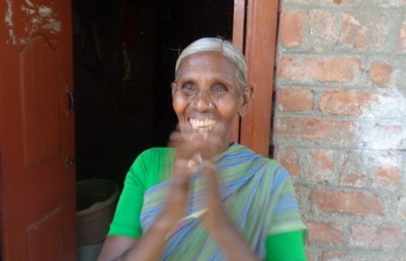 Woman from India claps happily after having her sight restored