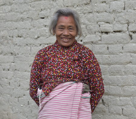 Woman from Nepal smiling happily into the camera now that her sight has been restored