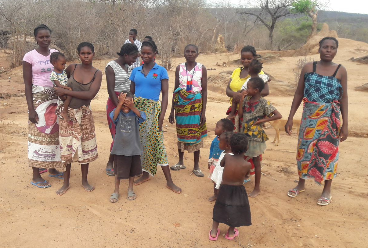 Women of Muuka village in Zambia watch as the water pump in their village is fixed.