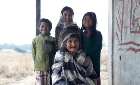 Indian woman with her grandchildren.