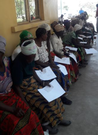Women in Zambia lining up to have their eyes screened at an Operation Eyesight screening and outreach program.
