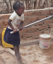 Little girl from Zambia now has access to clean water thanks to Operation Eyesight's donor-supported water programs to eliminate trachoma