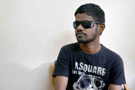 Young Indian man recovering after his corneal transplant.