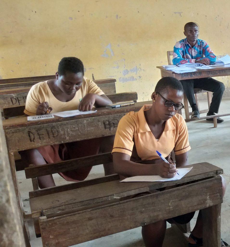 Jennifer sitting in her class, writing an exam