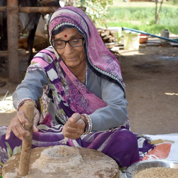 Kashi is grateful that she can continue to contribute to her family by doing domestic work.